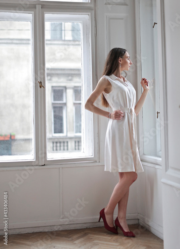 attractive woman looks out the window