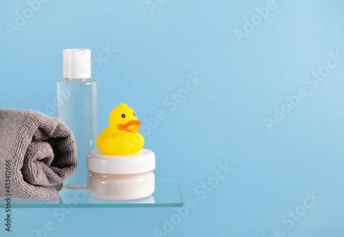 Fotografering Baby bath accessories on a glass shelf