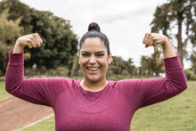 Plus Size Body Woman At City Park Posing Showing Biceps Muscles - Focus On Face