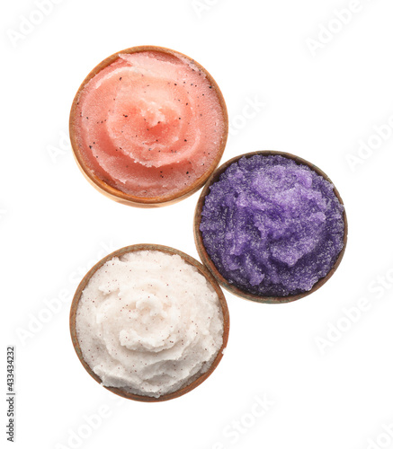 Obraz Different body scrubs in bowls on white background, top view - fototapety do salonu