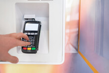 Person's Hand Enter Password And Push Buttons To Make A Payment