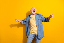 Photo Of Happy Excited Crazy Cheerful Smiling Grandfather Dancing Screaming Enjoying Free Time Isolated On Yellow Color Background