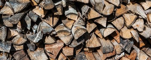 Fotografija Large stack of wooden raw chopped firewood background