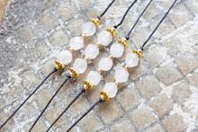Rose Quartz Cubic Cut Mineral Stone Bead Bracelet On Natural Background