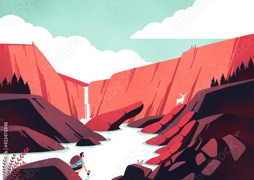 Obraz na płótnie In un paesaggio roccioso e montano una mano di pietra raccoglie l'acqua di un lago da cui una persona beve, osservata da un cervo