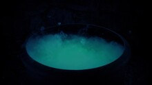 Witch Making Bubbling Brew In Cauldron