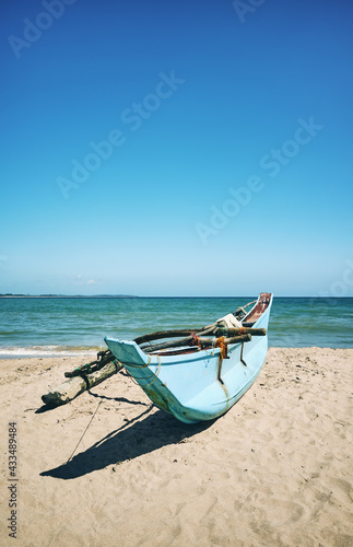 Small fishing boat on a beach, color toning applied, Sri Lanka. Fototapet