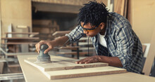 Young Black Man Carpenter Working In His Workshop.