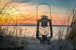 Öllampe Sonnenuntergang am Strand