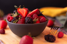 Detail View Of Bowl Full Of Strawberries And Cherries With Out Of Focus Background