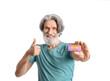 Senior man with gift card showing thumb-up on white background