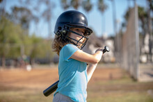 Boy Kid Holding A Baseball Bat. Pitcher Child About To Throw In Youth Baseball.