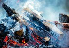 Close-up Firewood, Hot Coals And Ash. Lighting Barbecue Coals.
