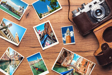 Vintage Retro Camera With Travel Photos On Wooden Background