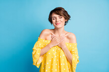 Photo Of Peaceful Happy Lady Hold Hands Chest Wear Summer Outfit Enjoy Isolated On Pastel Blue Color Background
