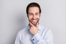 Portrait Of Attractive Cheerful Imposing Man Agent Broker Touching Chin Isolated Over Grey Pastel Color Background