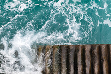 Stone Stairs Go Down In Stormy Sea Water