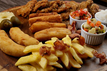 Cuban Fillet. Made With Breaded Steak, Cheese, Breaded Ham And Banana, Vinaigrette, White Rice, Pineapple And Fig. Close-up Photograph Of Typical Brazilian Dishes.