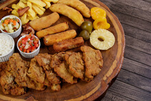 Cuban Fillet. Made With Breaded Steak, Cheese, Breaded Ham And Banana, Vinaigrette, White Rice, Pineapple And Fig. Top View Photo With Free Space For Text. Gastronomy