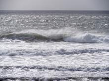 Breaking Waves And Seaspray, No Land, Bad Weather Sea Background. UK Grey.