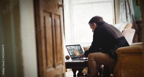 Senior caucasian man using laptop and having video call