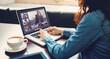 Caucasian businesswoman sitting at desk using laptop having video call