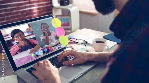 Caucasian male teacher sitting at desk having online lesson with pupil