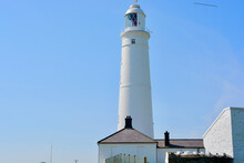 Nash Point Lighthouse In The Vale Of Glamorgan, Wales With A Blue Sky On A Sunny Spring Day