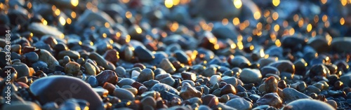 Sea shore at sunset, close-up. Pebbles, storm waves. Abstract background, details blurred in bokeh. Blue, yellow, orange, pink colors. Soft sunlight, golden hour. Peace, meditation, tranquility themes - fototapety na wymiar