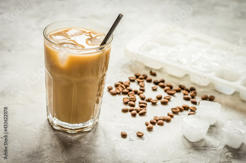 Obraz iced coffee with beans for cold summer drink on stone background - fototapety do salonu