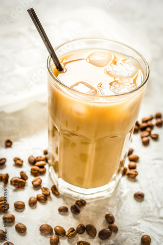 Obraz coffee ice cubes and beans with latte on stone desk background - fototapety do salonu