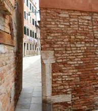 Very Narrow Passage Between The Houses Of The City Of Venice In Italy With The Streets Called CALLI