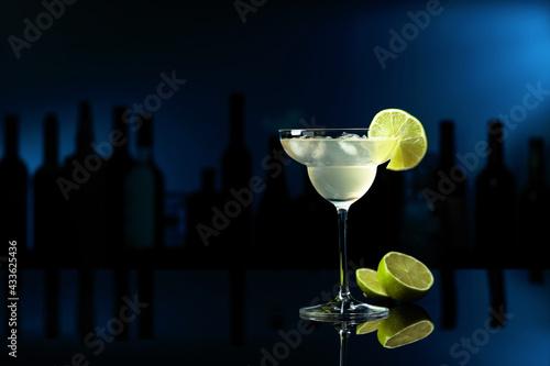 Obraz Cocktail Margarita on a black table in a bar. - fototapety do salonu