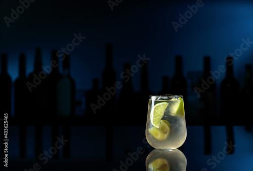Obraz Cocktail Caipirinha on a black table in a bar. - fototapety do salonu