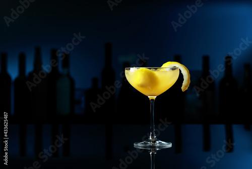 Obraz Cocktail Sidecar on a black table in a bar. - fototapety do salonu