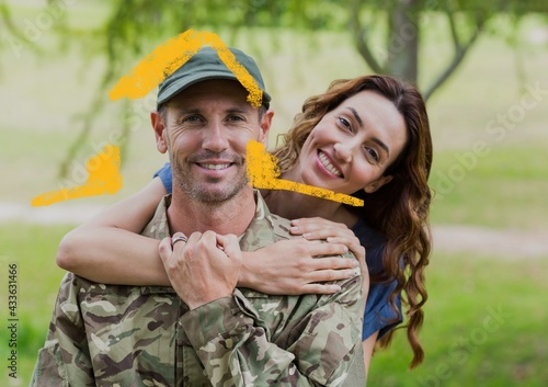 Composition of house drawing over portrait of smiling male soldier with his wife