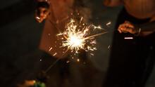 Blurry Of Children Having Fun Playing Fireworks