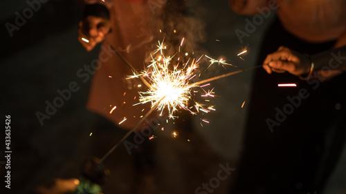Fotografie, Obraz Blurry of children having fun playing fireworks