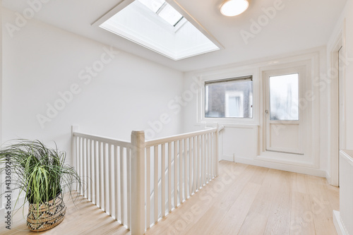 Fotomural Element of stairway with white decorative balusters and wooden railings in vinta