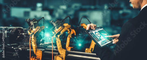 Fotografia Smart industry robot arms for digital factory production technology showing automation manufacturing process of the Industry 4