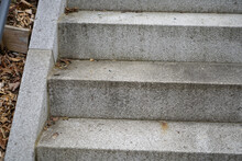 Closeup Of Outside Concrete Steps And Dry Autumn Leaves