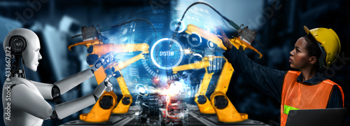 Fototapeta Mechanized industry robot and human worker working together in future factory . Concept of artificial intelligence for industrial revolution and automation manufacturing process . obraz