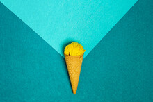 From Above Of Crunchy Waffle Cone With Small Woolen Thread Ball Representing Ice Cream On Colorful Background