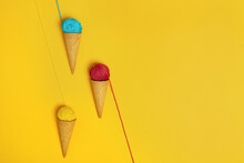 Colorful Woolen Thread Balls In Natural Crunchy Cones Representing Various Gelato On Yellow Background