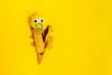 From Above Waffle Cone With Yarn Ball And Decorative Surprised Eyes And Mouth Made Of Rubber Band Representing Gelato And Face