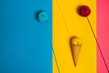 Colorful Woolen Thread Balls In Natural Crunchy Cone Representing Various Gelato On Three Color Background