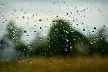 Spring Rain Drops On Car Glass