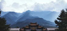 Part Of Curved Roof Of Ancient Buddhist Temple Located In Mountains In Yunnan