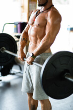Cropped Unrecognizable Strong Male Athlete Doing Deadlift With Heavy Barbell During Workout In Gym
