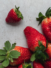 Top View Of Harvest Of Pile Of Fresh Strawberries Served On Table In Kitchen